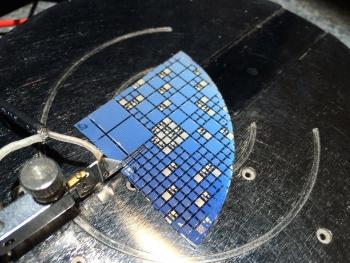 III-V/Si multi-junction solar cells developed at Ohio State University undergo illuminated current-voltage testing.