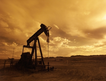 A solitary oil pump at the Teapot Dome Oilfield in Wyoming.   Department of Energy photo.