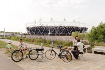 """Olympic stadium, with a roof made of 2,500 tons of steel tubing from recycled gas pipelines, is one example of sustainable design that is part of London's 500-acre Olympic Park. 