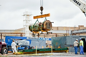 A 10,000-pound cold trap is lifted and boxed in a container for on-site storage at Paducah.