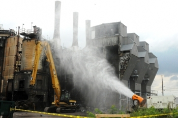 A high-pressure water cannon is used to control dust for the demolition of the X-600 Steam Plant.