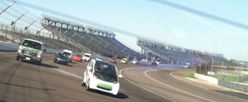 Hybrid vehicles circle the track at Indianapolis Motor Speedway as part of the inaugural Clean Cities Stakeholder Summit
