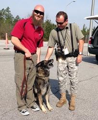 Wade Sumner, Dax's last handler at SRS, says goodbye to Dax as the dog rejoins his former handler, federal Special Agent Patrick Price.