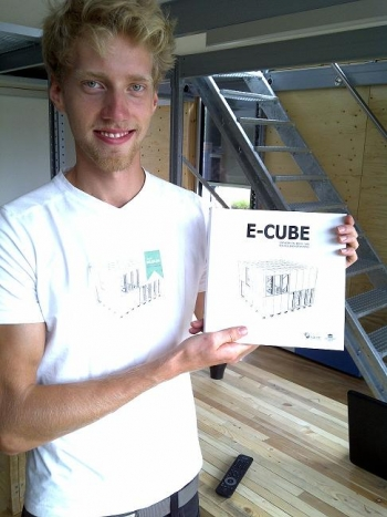 Pieter Jan De Loof, a student at Ghent University, displays the assembly instructions for E-Cube, Team Belgium's entry to the U.S. Department of Energy Solar Decathlon 2011.