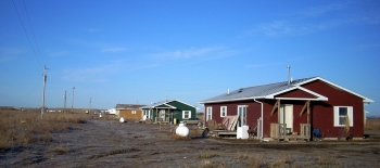 A row of homes on the Pine Ridge Reservation in South Dakota.