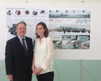 MIT's Carolyn Jenkins, shown here with the Energy Department's Bob Marley, was the winner of the C3E graduate student poster competition for her research on the East Boston Buffer as a transferable urban framework for adapting to sea rise.   Photo courtesy of the MIT Energy Initiative.