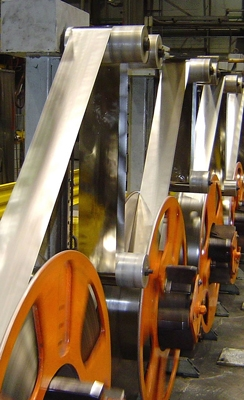 Giant spools at Metglas' facility in Conway, S.C., hold the thin metal alloy used in the cores of Amorphous Metal Transformers. | Photo courtesy of Metglas