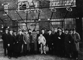 Electricity pioneer Charles Proteus Steinmetz (center in light-colored suit) poses with Albert Einstein (immediate left) and other inventors at the RCA Brunswick, New Jersey, wireless station in 1921. | Photo courtesy of Franklin Township Public Library Archive.