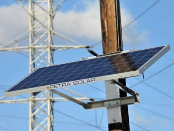 SunWave solar power systems are attached to utility poles, where they can gather sun power as well as provide a point of data gathering for utility companies to monitor the grid. | Photo courtesy Petra Solar