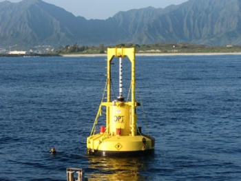 This experimental power-generating buoy installed off the coast of Oahu can produce enough energy to power 25 homes under optimal conditions.   Photo courtesy of Ocean Power Technologies, Inc.