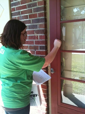 A volunteer canvasses the Mt. Washington neighborhood to spread awareness about home energy audits in the area. | Photo Courtesy GCEA