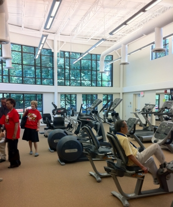 Seniors check out the new energy-efficient fitness facility at the Rockville Senior Center.   Photo courtesy of Chris Galm, Energy Department.