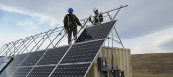 Subcontractor personnel install solar panels and other infrastructure on a 40-foot conex box that houses the batteries and control equipment for the 6 kilowatt photovoltaic system that powers the ETPTS groundwater treatment system.