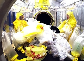 Workers sort through transuranic waste at the Savannah River Site.