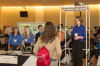 A student team from Issaquah, Washington, demonstrate their idea for an energy-saving shower at the Imagine Tomorrow competition last month.   Energy Department photo