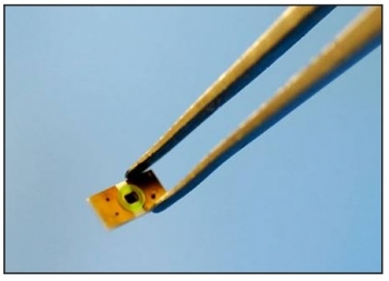 A tiny Semprius HCPV cell, mounted on an interposer.  Each cell is only 0.6mm on one side. | Photo courtesy of Semprius