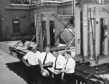 Checking a shipment of reactor fuel are, left to right, Samuel Edlow, U.S. Representative for Aktiebolaget Atomenergi of Sweden; S.D. Smiley, offsite fuels coordinator for the Du Pont Company at Savannah River; S.D. Tatalovich, Atomic Energy Commission international affairs representative; and Robert L. Chandler, chemical engineer with the Savannah River Operations Office.
