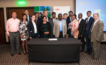 New partnerships between U.S. and South African organizations were recognized during a signing ceremony at the Powering South Africa Conference. From left to right: Jaime Cruz, Millenium Solutions; Edwina Felix, Peer Africa; Carsten Larsen, Dow; Sheila Moynihan, EERE; Bipin Shah, WinBuild; Teresa Scheepers, Municipal Manger of !Khies; Minister Counselor Laird Treiber, U.S. Embassy; Logesh Janarthanan, EMPORes LLC; Dr. Xiahohua Xia, University of Pretoria; Mothusi Guy, PEER Africa; Nothemba Mlonzi, SANEDI Board of Directors; David Mahuma, SANEDI; Dr. Ravi Srinivasan, University of Florida; Barry Bredenkamp, SANEDI. | <em>Photo credit: Ignus Gerber Photography</em>