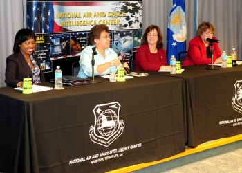 Dot Harris, Director of the Office of Economic Impact and Diversity, speaks with Aurea Rivera, President and CEO of Imagineering Results Analysis Corp., Kathleen Tucker, Director of the Information Exploitation Squadron, Global Exploitation Intelligence Group, NAISC, and Ann Carbonell, Chief of the National Geospatial Intelligence Agency Support Team in September 2013. Photo by National Air and Space Intelligence Center.