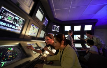 Stanford Physics Professor Pat Burchat and student Ho Jeong Kim in the BaBar main control room at the SLAC National Lab. | Photo courtesy of the SLAC National Accelerator Lab.