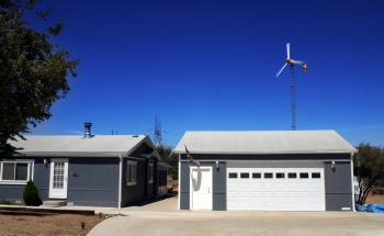 A small wind turbine can produce enough energy to cover the electricity costs of the average American home. | Photo from Bergey Windpower Co., Inc.; NREL 13830