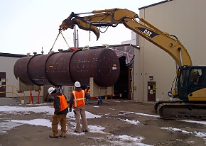 A tank at the Materials and Fuels Complex containing residual sodium is moved prior to waste treatment.