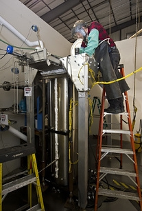 Distillation equipment is shown prior to transport to the Idaho site.