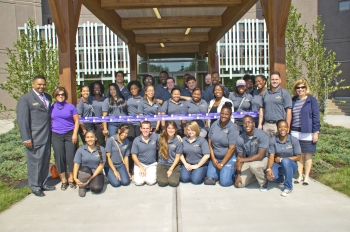 Students celebrate the ribbon cutting at their energy efficient housing center. | Photo courtesy of the University at Albany.