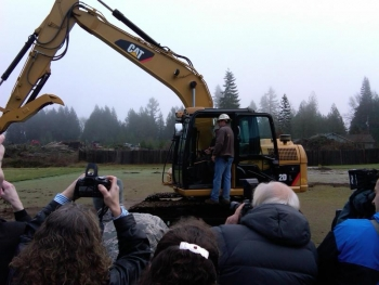 Oregon Governor Kulongoski maneuvers a backhoe to break ground at the Vernonia school site. | Department of Energy Image | Photo by Joel Danforth, Contractor | Public Domain |