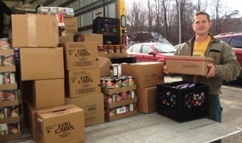 Volunteer John Schelble helps unload a delivery truck at a food pantry.