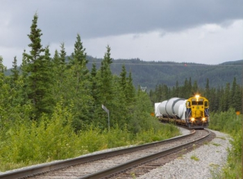 A train carrying wind turbine components arrives in Alaska. The components were then transported to the Eva Creek Wind Farm site. | Photo courtesy of Golden Valley Electric Association