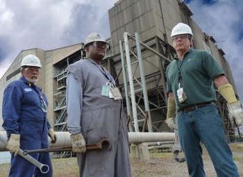 SRNS Maintenance Supervisor Steve Cooper, left to right, Control Room Operator Robert Dicks, and Deputy Operations Manager Ren 