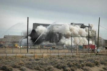 Workers demolish the Test Area North Hot Shop Complex, shown here.