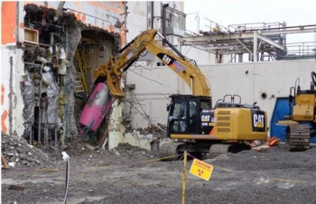 Demolition continues in April 2013 with removal of internal components and concrete cell walls.