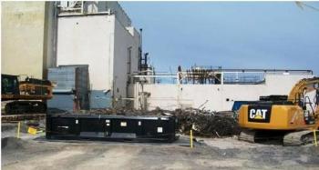 Debris is removed following demolition.