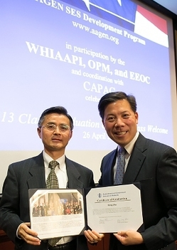 EM's Dr. Ming Zhu, left, receives his certificate from Chris Lu, former Assistant to the President and Cabinet Secretary, at the AAGEN SES Development Program graduation ceremony in Washington, D.C. in April.