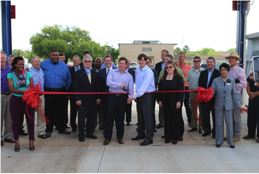Local Dignitaries Cut The Ceremonial Ribbon During The Opening Of The CNG  Station At Ivan Smith