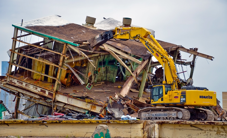 Once the building was down, heavy equipment operators began top-down
