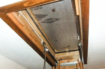 Sealing gaps in the opening and installing an insulating cover box on your attic stairs access can improve comfort and save energy and money. | Photo courtesy of U.S. Department of Energy's Weatherization Assistance Program.