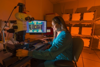 Sandia National Laboratories researcher Rachelle Thompson studies how radiation affects electronics within a W76-1 warhead. | Photo courtesy of Sandia National Laboratories.