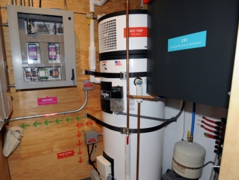 This utility room includes a heat pump water heater. | Photo courtesy of Thomas Kelsey/U.S. Department of Energy Solar Decathlon