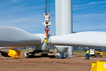 Workers use a giant crane to lift the blade assembly on a wind turbine at NREL's National Wind Technology Center. | Photo by Dennis Schroeder.