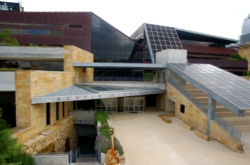 The City Hall in Austin, Texas was designed to reflect its natural surroundings. The four-story building incorporates local limestone, a waterfall and nonsymmetrical shapes, meant to reflect the waterways and canyons of the area. The building also includes amphitheater seating shaded by solar photovoltaic panels. An EPA Green Power Partner since September 2006, the City of Austin uses more than 370 million kilowatt-hours of renewable electricity annually.