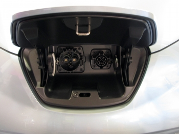 The standard J1772 electric power receptacle (right) can receive power from Level 1 or Level 2 charging equipment. The CHAdeMO DC fast charge receptacle (left) uses a different type of connector.