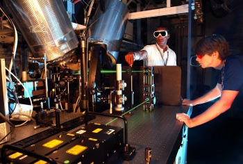 Researchers take laser-based velocity measurements at the Sandia National Laboratory's Combustion Research Facility.