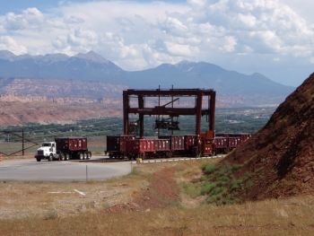 One of two gantry cranes that load and unload tailings containers from the railcars is pictured on the hillside rail bench west of Moab