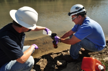 Employees conduct soil and water samples to determine which areas require cleanup.