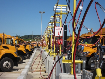 Refuse trucks in Oyster Bay, Long Island, filling up at a natural gas station. These trucks were part of a project supported by the Vehicle Technologies Office through Clean Cities.