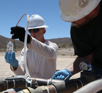 Field personnel collect groundwater samples at a well in Yucca Flat as part of the NNSS groundwater characterization program.  Though contamination from underground testing has never been detected on public land, DOE is committed to developing an advanced, reliable monitoring network that ensures the long-term protection of the public.  Risks associated with contamination remain low due to the immobility of some contaminants and the extremely slow movement of others.