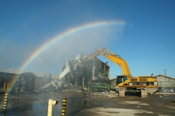 A rainbow appears over the Paducah Site's East End Smelter, a 21,000-square-foot complex used until the 1980s to smelt metal. Recovery Act workers used heavy equipment to demolish the smelter in September 2010, a year ahead of schedule and $10 million under budget.